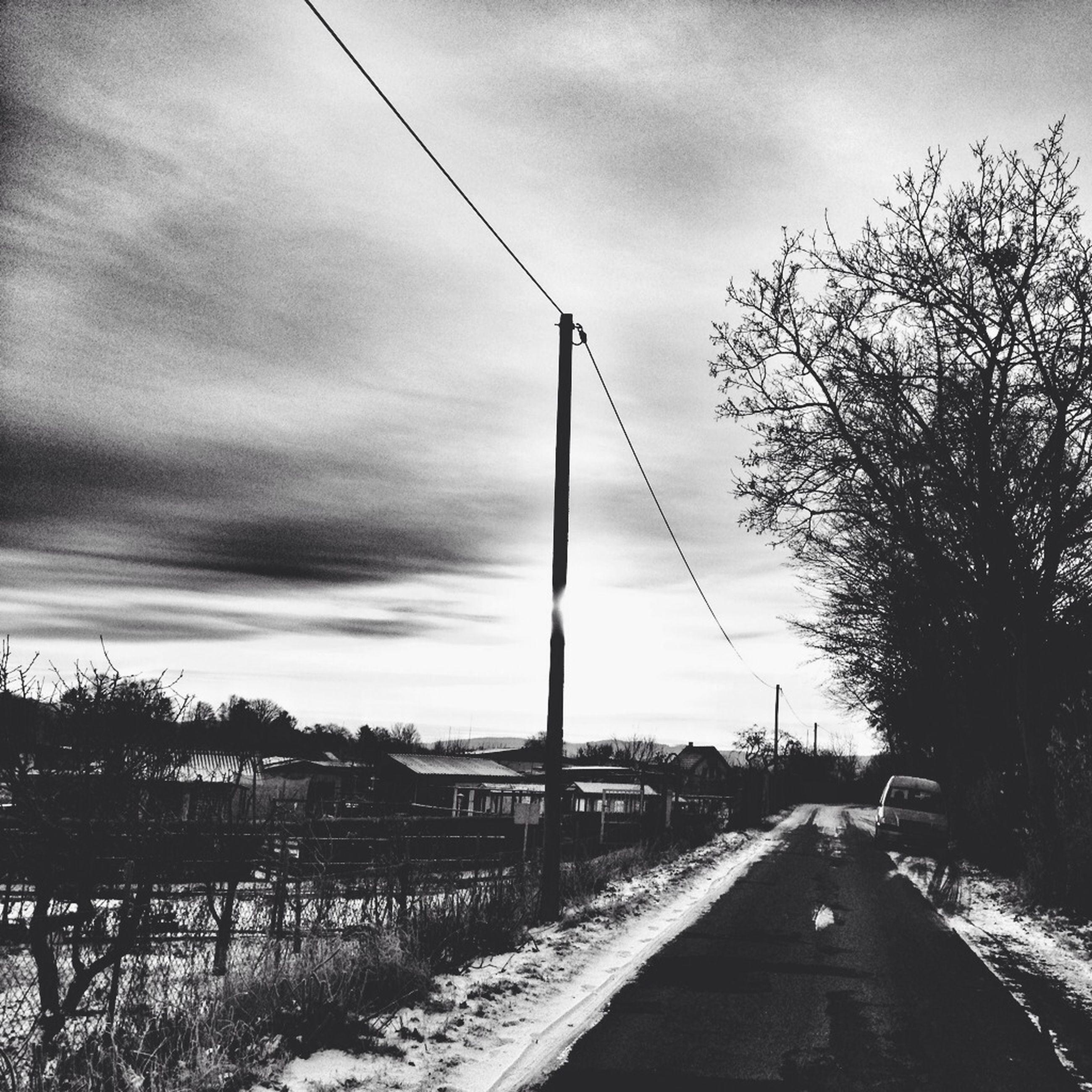 sky, the way forward, cloud - sky, cloudy, road, weather, tree, diminishing perspective, tranquility, transportation, cloud, nature, bare tree, tranquil scene, vanishing point, snow, winter, overcast, electricity pylon, outdoors