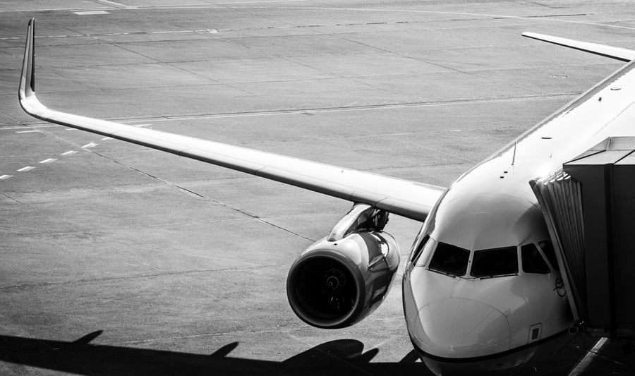 Aeroplane Travel Destinations Traveling Airport Gate Ramp Black And White Public Transportation Airplane Air Vehicle Transportation Mode Of Transportation Airport Travel Airport Runway Aircraft Wing High Angle View Sunlight Outdoors Journey Runway Commercial Airplane Land Vehicle Jet Engine Stationary
