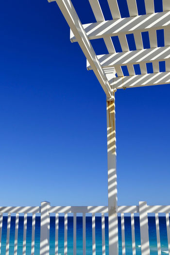 View point of beach in Cancun, Mexico Cancun Architecture Barrier Beach Blue Boundary Built Structure Clear Sky Copy Space Day Fence Low Angle View Nature No People Outdoors Pattern Railing Sky Sunlight Water White Color