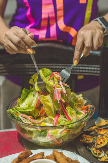 Healthy living! Food And Drink Food Midsection Freshness Holding Real People One Person Human Hand Hand Indoors  Healthy Eating Table Human Body Part Vegetable Women Kitchen Utensil Close-up Preparation  Focus On Foreground Preparing Food Salad Vegetable Salad