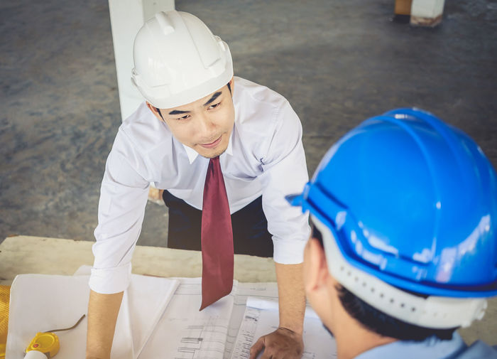 Midsection of woman working at construction site