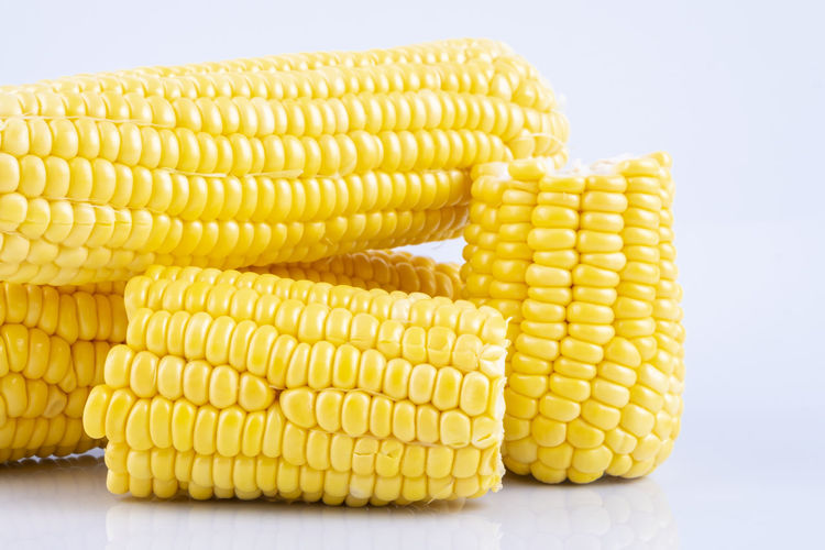 fresh raw sweet corn on the cob kernels over white background Yellow Food And Drink Food Wellbeing Healthy Eating Vegetable Corn Sweetcorn Close-up Indoors  White Background Freshness Corn On The Cob Studio Shot No People Agriculture Raw Food Crop  Still Life Corn - Crop Vegetarian Food