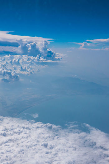 Above Aerial View Beauty In Nature Blue Cloud - Sky Cloudscape Day Environment Fluffy Heaven Idyllic Meteorology Nature No People Outdoors Scenics - Nature Sky Softness Tranquil Scene Tranquility Water White Color
