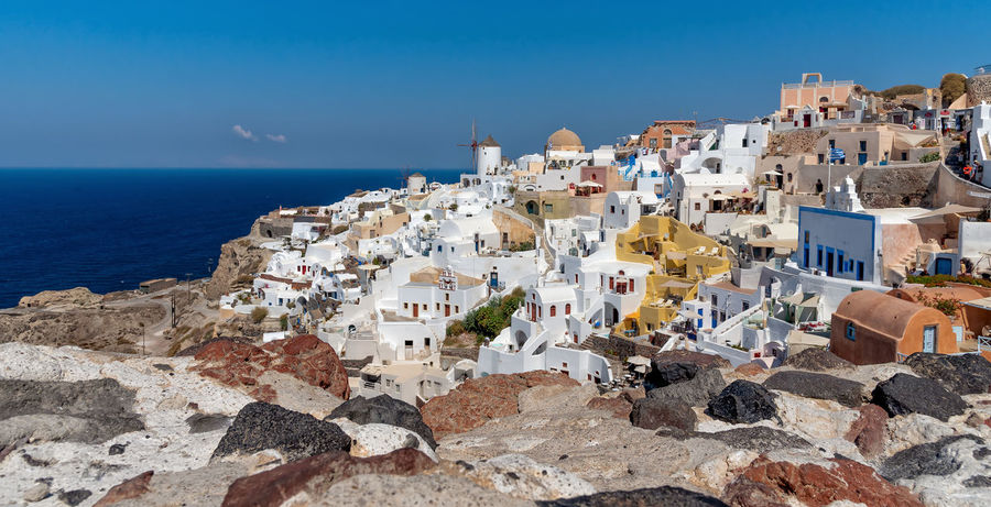 View of Oia - Santorini Cyclades Island - Aegean sea - Greece Building Exterior Architecture Built Structure Sea Building Water Residential District House No People Blue Nature Town Horizon Over Water City Travel Destinations Tourism Travel Outdoors TOWNSCAPE Oia Santorini Greece Aegean Island Volcano