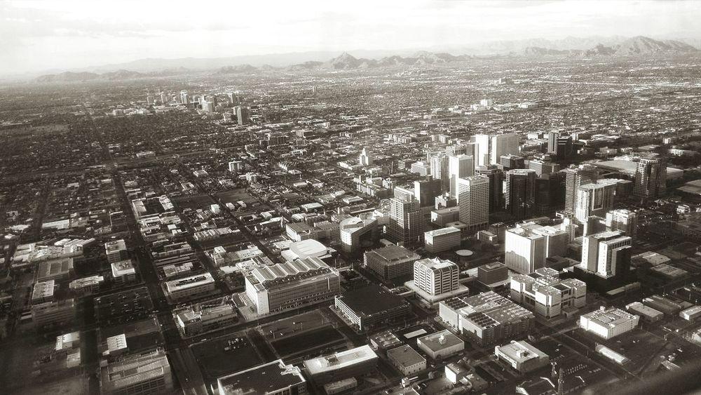 Phoenix Flying In Cityscape