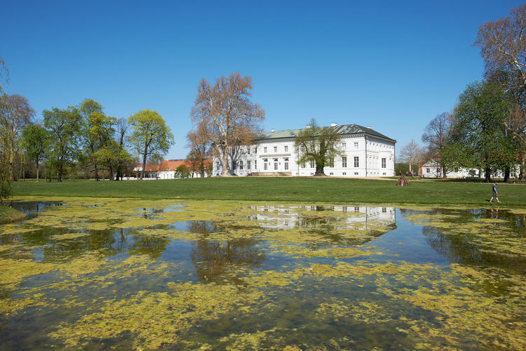 neuhardenberg palace and park against blue sky Architecture Built Structure Building Exterior Plant Tree Water Nature Building Sky Day Reflection Lake Clear Sky Mansion House Travel Destinations No People Grass Outdoors Luxury Neuhardenberg Spring Oderbuch Brandenburg Schinkel Countrside Park Neuhardenberg Palace Springtime Spring Is Coming  Spring Is In The Air Palace