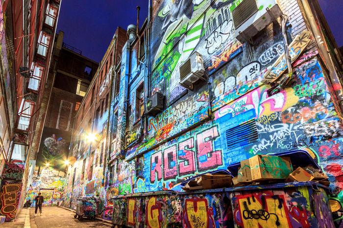 Low shot of a famous laneway with graffiti Graffiti Advertisement Alley Architecture Art Building Building Exterior Built Structure City City Life Commercial Sign Communication Creativity Graffiti Illuminated Low Angle View Multi Colored Night Non-western Script Outdoors Script Store Sign Street Text
