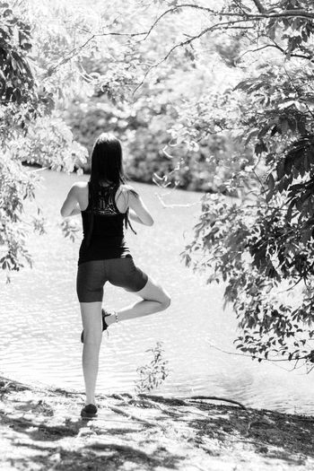 Young Woman Doing Yoga In Forest