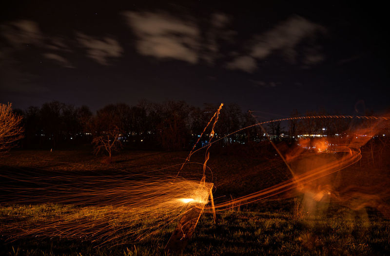 Fasnetfeuer und Scheibenschlagen in Weil am Rhein - Haltingen Fasnet Fasnacht Scheibenschlagen Sky Night Illuminated Cloud - Sky Nature Long Exposure Motion Land Blurred Motion Field Glowing Plant Transportation Outdoors Water Tranquil Scene