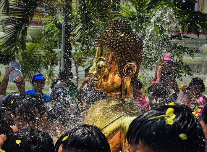 Buddha Statue Amidst Crowd During Festival