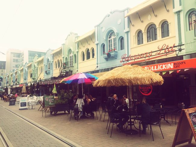 Restaurant Sidewalk Cafe Building Exterior Table Architecture Outdoors Sunshade Travel Destinations Built Structure Chair Awning City Market Stall Sky Large Group Of People Colors Colorful Street Cafe