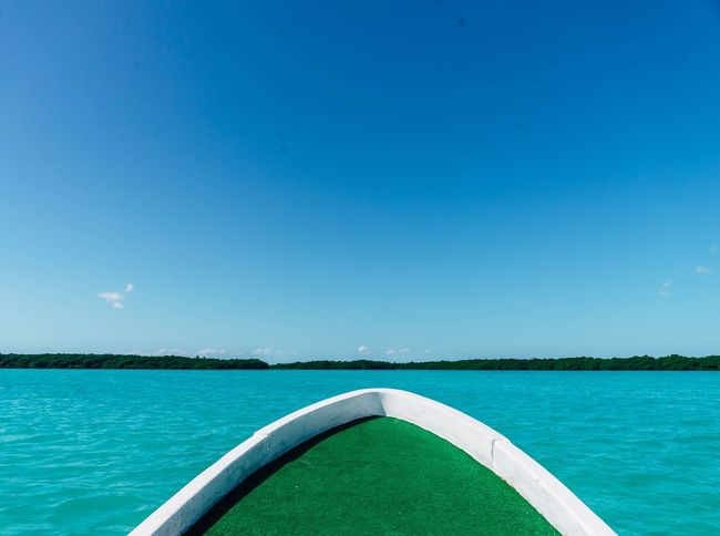 Blue Water Sea Clear Sky Scenics Tranquility Nature Beauty In Nature No People Outdoors Day Tranquil Scene Sky Boat Mangrove Forest Copy Space Caribbean Be. Ready.
