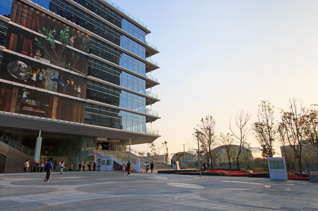 Kaohsiung, Taiwan - February 19,2015: The Kaohsiung Main Public Library at sunset. This structure is also know as Green Library is the first green suspension structure in the world. Architecture ASIA Blue Building Building 85 Built Structure City City Life City Street Day Diminishing Perspective Dusk Façade Green Library Iconic Buildings Kaohsiung Kaohsiung, Taiwan Lifestyles Modern Buildings Outdoors Sky Sunset Taiwan The Way Forward