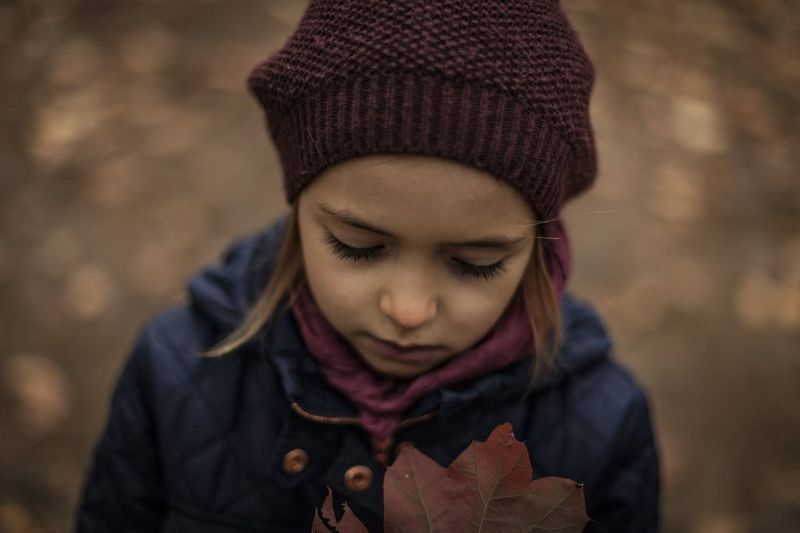 Close-up of girl wearing knit hat during autumn