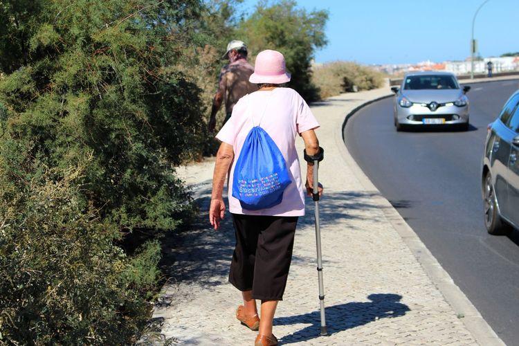 Rear view of friends walking on street