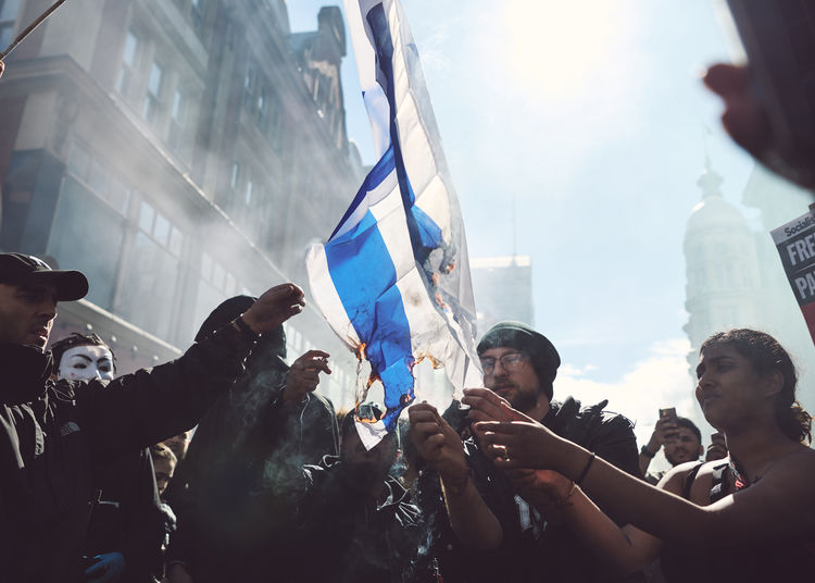 Group of people holding flag in traditional building