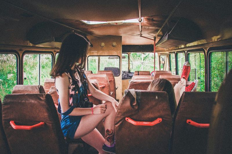 Side view of girl on bus