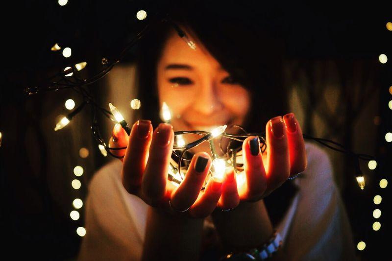 Lightning One Person Real People Holding Illuminated Indoors  Lifestyles Leisure Activity Women Night Light - Natural Phenomenon Focus On Foreground Selective Focus Lighting Equipment Light