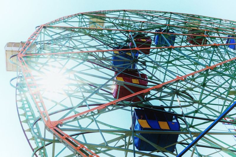 Amusement Park Amusement Park Ride Ferris Wheel Low Angle View Arts Culture And Entertainment Sky Built Structure Multi Colored Geometric Shape Traveling Carnival Metal No People Circle Day Shape Carnival Outdoors Fun Nature Architecture