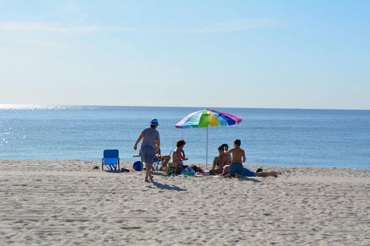 People enjoying at sandy beach