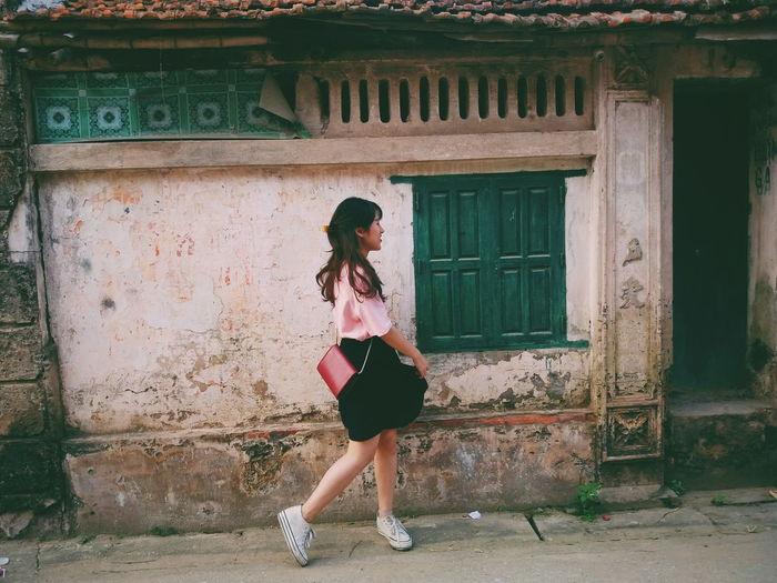 Walking fast, faces past and I'm home bound Hometown People And Places Vintage Village Life Outdoors Joy Movement TakeoverContrast My Year My View Smiling One Person Girl Vietnamese Uniqueness Miles Away The Portraitist - 2018 EyeEm Awards My Best Photo My Best Photo International Women's Day 2019