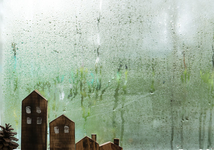 Wet glass window of building