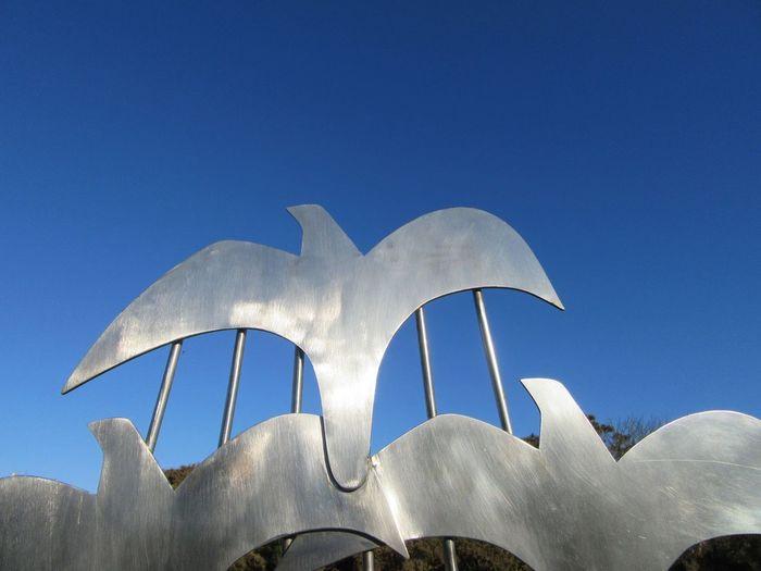 Learn & Shoot: Balancing Elements Bird Sculpture Stainless Steel  Blue Sky Mizen Peninsula West Cork Wildatlanticway Ireland