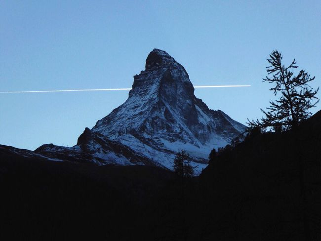 Mountain Low Angle View Tranquility Scenics Snowcapped Mountain Snow Contrail Beauty In Nature Selected For Premium Outdoors The Premium Collection Transportation No People Day Landscape Mountain Peak Cold Temperature Matterhorn  Zermatt Switzerland Contrails EyeEmSwiss Idyllic Winter Mountain Range