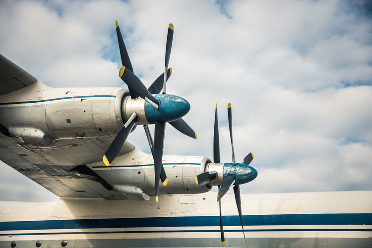 Old propellers Air Vehicle Airplane Airport Cloud - Sky Day Flying No People on the move Plane Propeller Sky Steel Transportation Travel