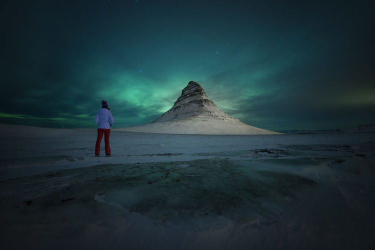 Aurora Borealis Ice Kirkjufell Tranquility Winter Beauty In Nature Full Length Idyllic Land Leisure Activity Lifestyles Model Mountain Nature One Person person Real People Rear View Scenics - Nature Sea Sky Space Standing Tranquility Water Go Higher Go Higher