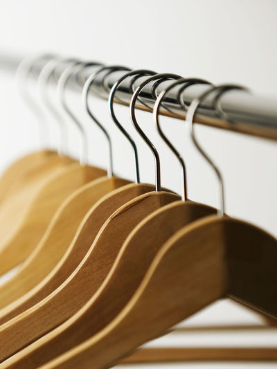 Close-up of coathangers hanging on rack