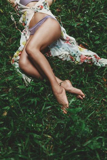 Low section of woman legs on field
