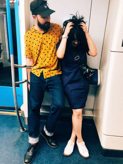 Man and woman standing on tiled floor
