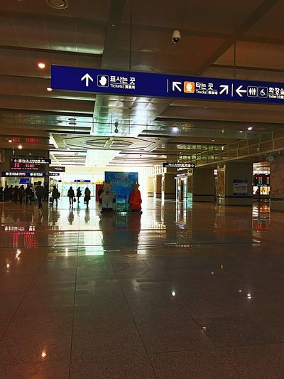Airport Travel Transportation Tiled Floor Indoors  Illuminated Communication Airport Departure Area Waiting Built Structure Text People Architecture Airport Check-in Counter Adults Only Moving Walkway  Adult