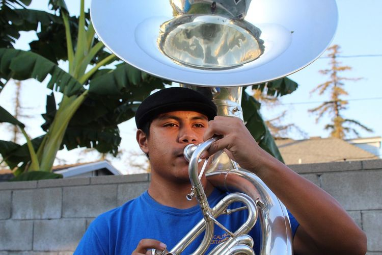 Young musician EyeEm Selects Portrait Holding One Person Real People Day Blowing Brass Instrument  Music Musical Instrument Musician Performance Outdoors