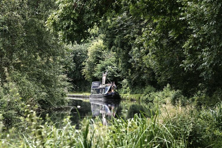 Passenger craft on river at smestow valley local nature reserve