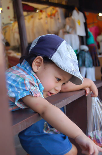 Portrait of a boy, Asian Age 2 years at the floating market. Boys Cap Casual Clothing Child Childhood Cute Day Focus On Foreground Hat Innocence Leisure Activity Lifestyles Looking Males  One Person Portrait Real People
