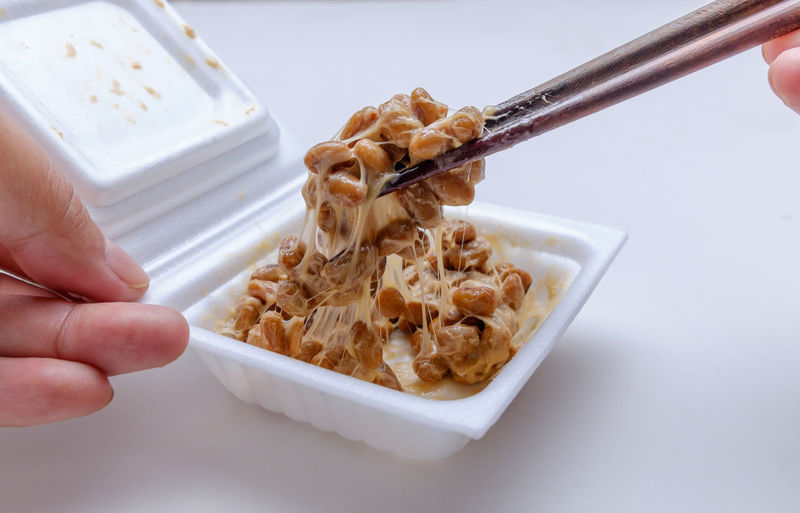 Pick a mixed natto by chopsticks Bowl Breakfast Close-up Fermentation Fermented Food Freshness Gummy Healthy Eating Holding Human Body Part Human Hand Japanese Food Mixed Natto One Person One Woman Only Only Women People Picking Up Ready-to-eat Soy Soybean