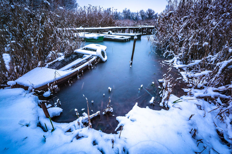 Snow Covered Boat Tranquil Scene Non-urban Scene Natural Ice Frozen Frost Waterfront Riverside River Outdoors Snow Plant Beauty In Nature Tree Cold Temperature Winter No People Nature Day Tranquility Mode Of Transportation Transportation Water
