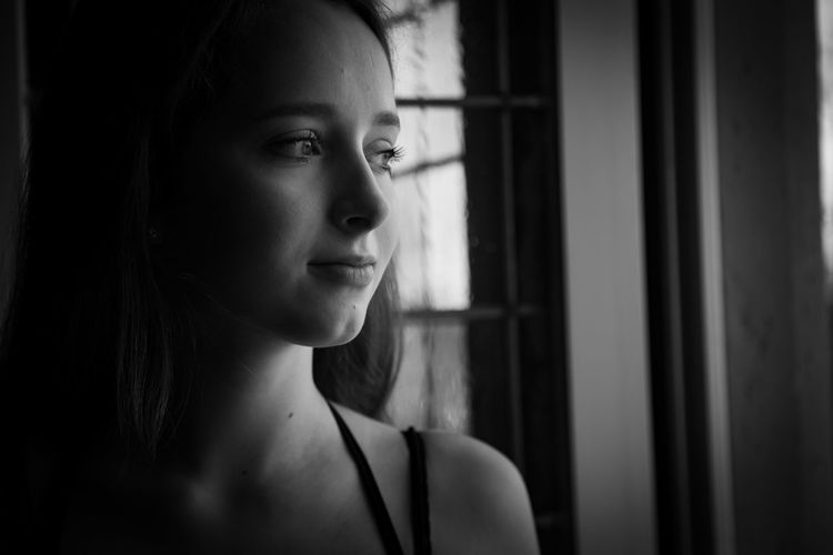 Lisa EyeEm Selects Young Women Beautiful Woman Beauty Portrait Beautiful People Women Headshot Loneliness Depression - Sadness Window Looking Through Window Film Noir Style Pretty Attractive Head And Shoulders