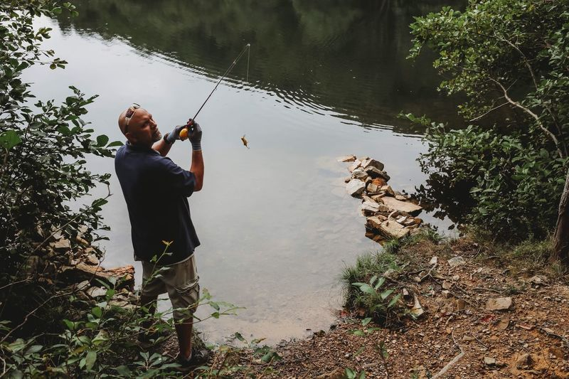 A bad day of fishing is better than a good day at work. -unknown Sportsman Outdoor Life Outdoors Explore Sherando Lake Virginia Water Nature Fishing Pole One Man Only Nature Lake Leisure Activity Fishing