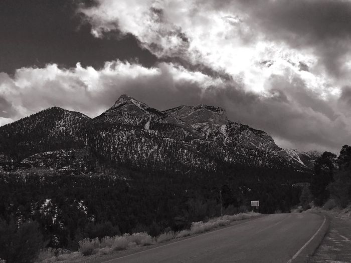 Scenic view of mountains against storm clouds