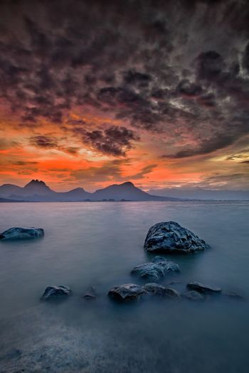 , Beautiful sunset at Jatiluhur Dam Purwakarta Rock Beautiful Clouds Beautiful Clouds &sky Beautiful Sky Beautiful Skies Jatiluhur Damn Nature Mountain Purwakarta Sea Sunset Water Red Beach Sky Landscape Romantic Sky Seascape Ocean Dramatic Sky Storm Cloud Thunderstorm Sky Only Horizon Over Water