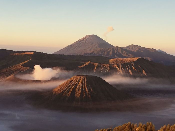 View of volcanic mountain range against sky during sunset
