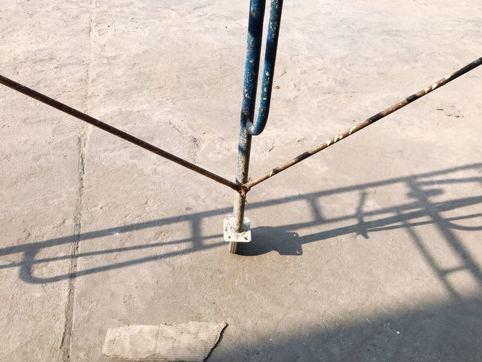 High angle view of chain hanging on rope