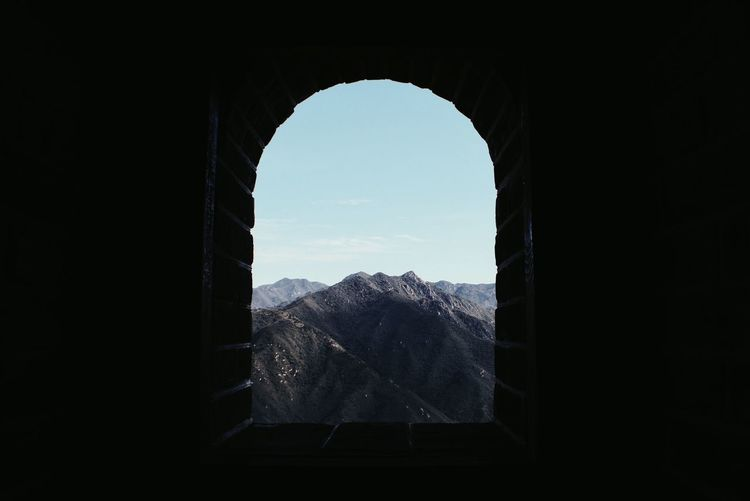 Scenic view of mountains seen through window