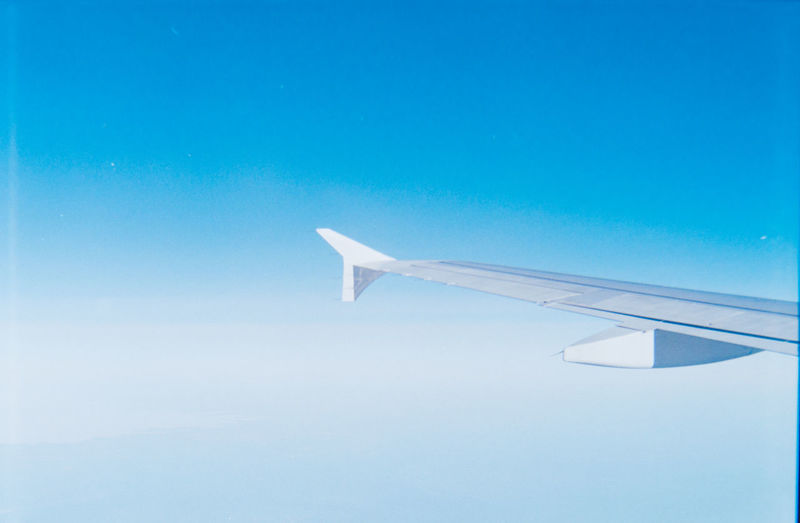 Air Vehicle Aircraft Wing Airplane Airplane Wing Blue Clear Sky Day Flying Journey Mode Of Transport Nature No People Outdoors Public Transportation Sky Transportation Travel