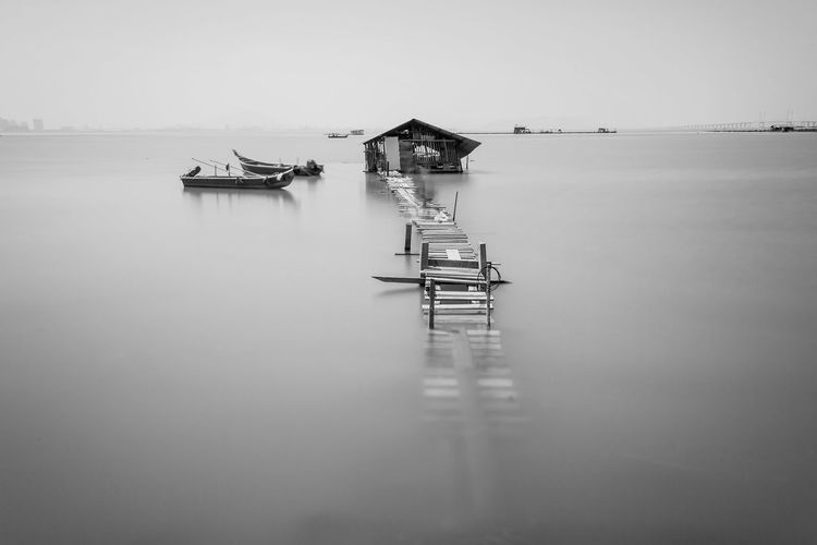 Overflow broken wooden bridge view Classic Overflow Print Beauty In Nature Blacckandwhite Black And White Bridge Clear Sky Day Nature Nautical Vessel No People Outdoors Scenics Sea Sky Tranquil Scene Tranquility Village Water Waterfront Wooden