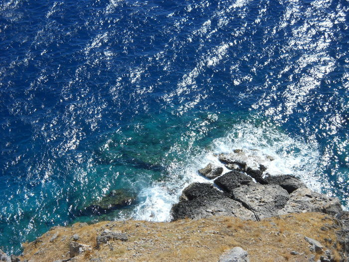Greek Islands Rhodes Rhodes, Greece Acropolis Acropolis, Lindos Aquatic Sport Beach Beauty In Nature Blue Breaking Day Greece High Angle View Land Lindos Lindos Greece Motion Nature No People Outdoors Power In Nature Rock Rock - Object Scenics - Nature Sea Solid Sport Water Wave