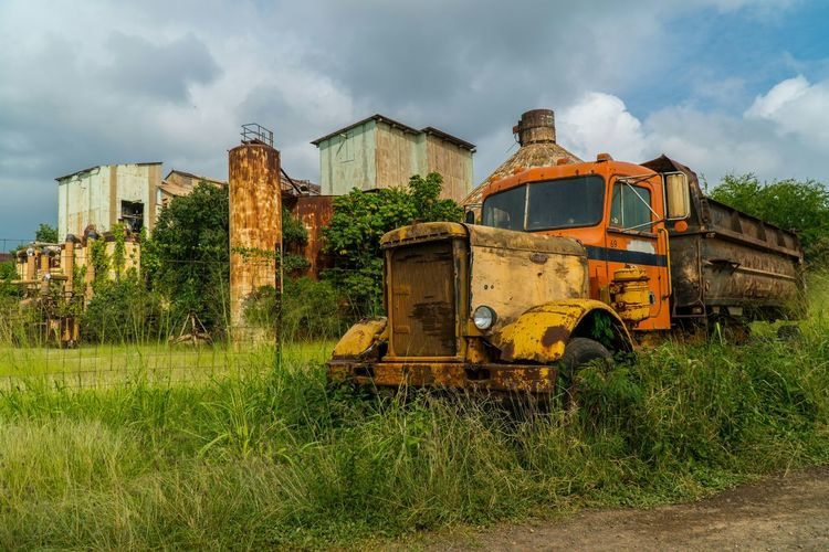 Abandonded Cars Abandoned Mode Of Transport Damaged Rusty Bad Condition Land Vehicle Sky No People Cloud - Sky Outdoors Day Sugar Mill EyeEmNewHere Travel Sony A6300 Truck Old Buildings Old Truck Old Kauai, Hawaii EyeEm Best Shots EyeEm Best Edits Another Angle Multi Colored Miles Away Lieblingsteil The Street Photographer - 2017 EyeEm Awards EyeEm Selects